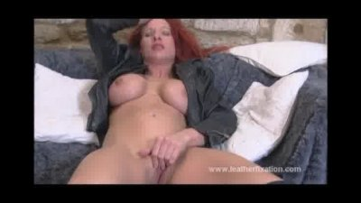 Busty biker babe gets horny and masturbates in her leather gear