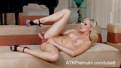 Sexy blonde Brea Bennett fucks her tight pussy