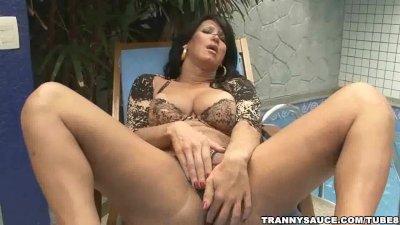 foxy brazilian shemale babe rubbing on her cock