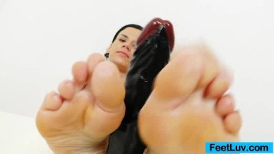 Black fake cock gets a footjob