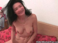 Granny gets her hairy pussy finger fucked by the photographer
