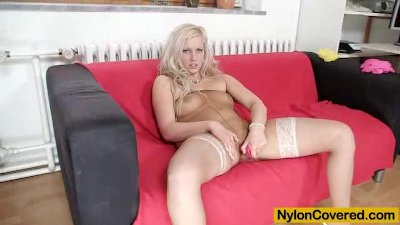 Well-endowed Nataly Gold covered in tights
