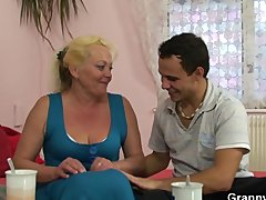 Flabby oldie spreads her legs for young dick