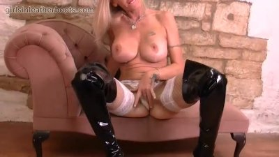 Horny Milf fingering her soft pussy lips in sexy leather boots