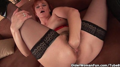 Sleazy grandma in nylons fist fucks her hairy cunt