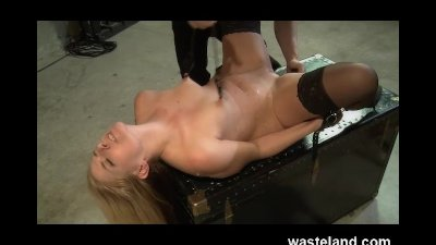 Dungeon Master Cuffs Sub and Whips her While Punishing Her Pussy With Dildo