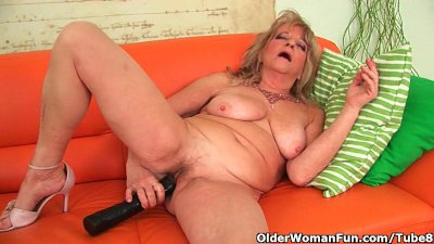 grandmother with large breasts pushes monster dildo inside