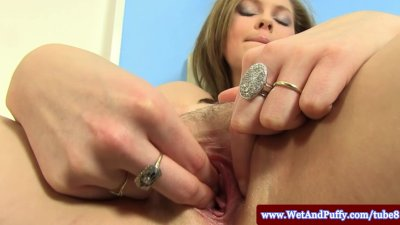 Puffy peach cutie plays with moist pussy