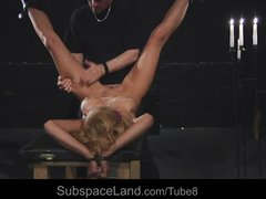 Bound tightly and punished roughly in a waxed bdsm game