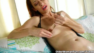 Pantyhosed milf with hard nipples fucks herself
