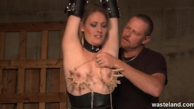 She is whipped and her nipples are pegged