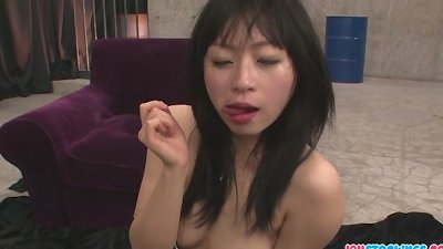 Nozomi Hazuki in stockings gives an asian blow job for cum