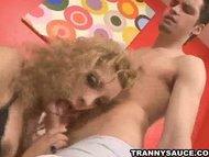 Yummy blonde tranny babe sucking on a hard cock