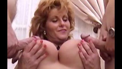 Busty Mindy Jo sucking and fucking two cocks