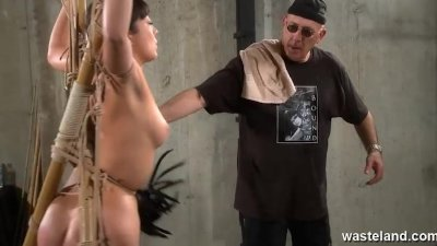 Older master ties and flogs Oriental slave girl