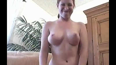 Busty Ginger strips and masturbates her pussy