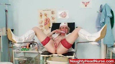 Perverted Lady in nurse uniform shows huge boobs