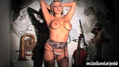 Busty blonde strip tease on stage plays with her big tits and tight pussy