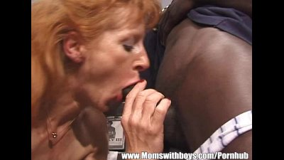 Mature Ginger Slut Has Threesome With Black And White Dudes