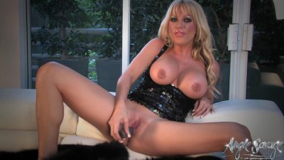 Sexy blonde stuffs her tight wet pussy with her toy