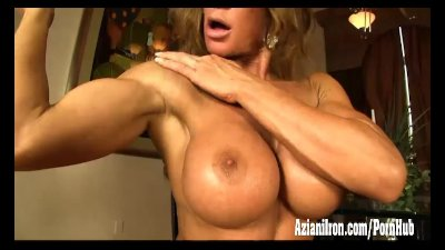 Fitness babe strips out of her catsuit and finger fucks her wet pussy