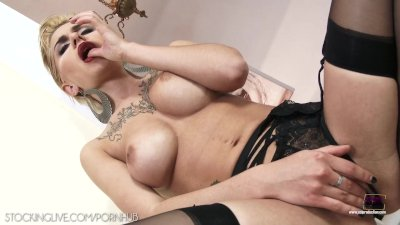 Mind blowing blonde gets naughty with a black dong in stockings