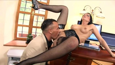 Sexy secretary fucked on a desk in black fishnet stockings and high heels