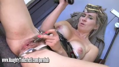 Naughty army girl Tinkerbell fucks her pussy and ass with big hard bullets