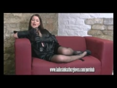 Horny brunette has phone sex playing with boobs and pussy in leather gloves