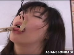 Asian brunette getting roped up and tongue pegged