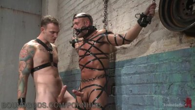 Muscled Hunk Suspended In The Meat Locker