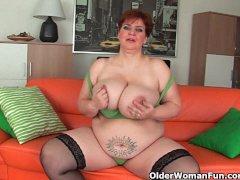 Aged BBW with massive boobs fucks a long dildo
