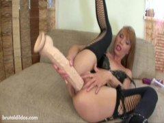 Vanda gapes her asshole with massive dildos