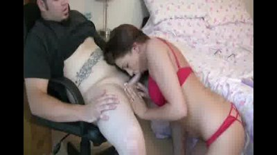 Brunette babe in red lingerie sucking her boyfriends cock
