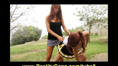 Horny Young redhead cheerleader sluts dildofuck pussies at park