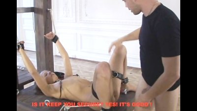 A hot cutie gets her shaved pussy pounded on the bondage stand