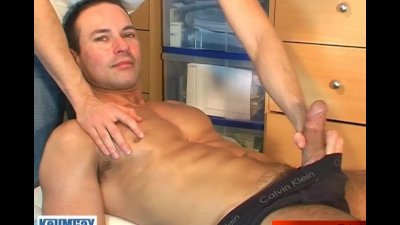 a very cute swimmer guy get wanked by a gay guy