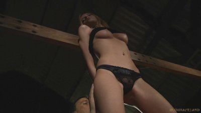 Blonde young slave is fucked in chains