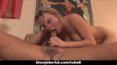 Horny MILF gags on huge cock