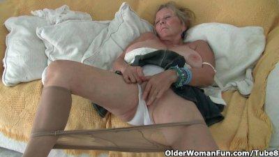 Granny with big tits masturbates in pantyhose