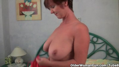 Granny loves to tease with her big tits and juicy pussy