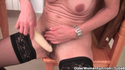 Dildo Masturbation Milf video: Granny in black stockings masturbates her hairy pussy with dildo