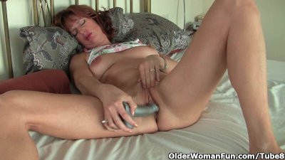 Fingering Solo Milf video: Mature redheaded mom masturbates with sex toys