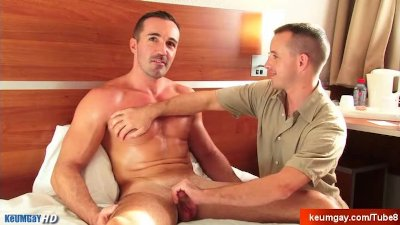 A sexy mature sport guy serviced his dick by a 23 y.o guy in spite of him