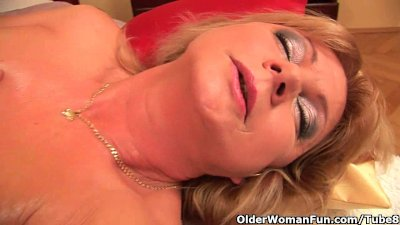 Grandma with big tits finger fucks her oiled pussy