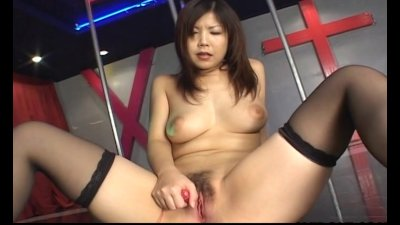Pretty Asian teen masturbates on stage