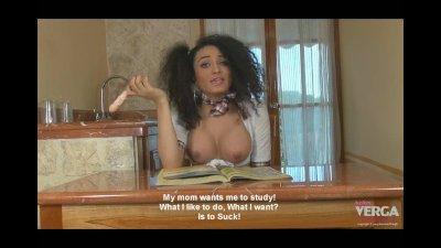 Keira Verga with a dildo at her schook desk.