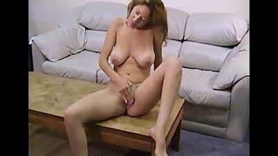 Busty Lilianna masturbates her pussy