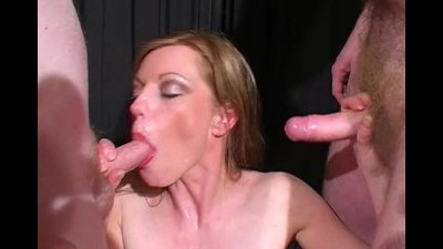 British redhead takes facials in a bukkake party