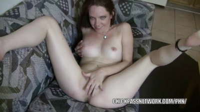 Petite redhead Raine fucks her pussy with her fingers